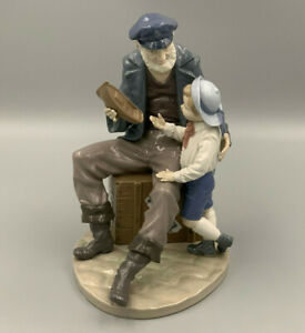 """Lladro """"A Tall Yarn"""" 5207 Sailor with Young Boy Large Figurine."""
