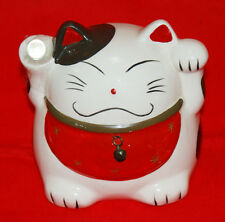 Savings bank of Maneki-neko (a welcoming cat) having a ball of the good luck