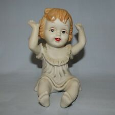 BISQUE PIANO DOLL GIRL SITTING PIANO BABY