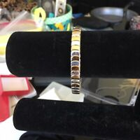 Silver And Gold Tone Stretch Bracelet.