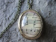 VINTAGE SHEET MUSIC GLASS CABOCHON BRONZE LOCKET - MUSICIAN - MUSIC TEACHER