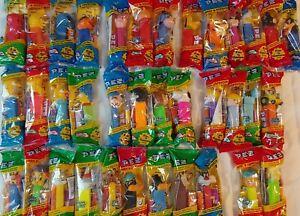 Lot of 36 Pez Dispensers- Looney Tunes/Simpsons/Winnie the Pooh/Sesame Street