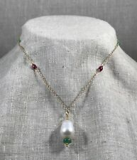 Beautiful pearl and emerald teardrop pendant on ruby, emerald and gold chain