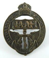 Royal Navy, Army and Air Force Institute NAAFI Cap Badge with issue number 46371