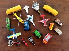 Lot of 18 die cast planes, helicopters, school bus, cars and trucks 1/64 scale