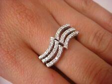 18K WHITE GOLD, LADIES WAVE DESIGN DIAMOND BAND-RING 0.60 CT T.W. 8.6 GRAMS,
