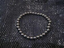 Wonderful simple hematite coloured plastic beaded elasticated bracelet