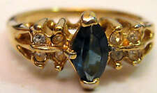 Beautiful Gold Tone Ring with a Center Blue Stone Surrounded by Clear Stones