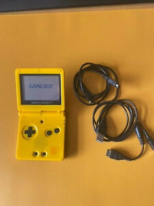 Nintendo Game Boy Advance SP Console - (Replacement Pikachu shell) and cables