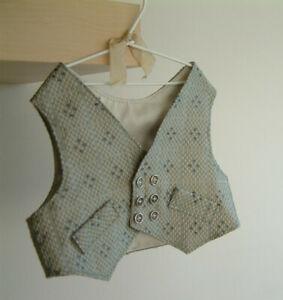 A handmade silk waistcoat for a teddy bear.