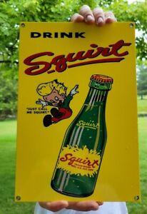 OLD VINTAGE HEAVY METAL SQUIRT PORCELAIN GAS STATION SIGN SODA POP ADVERTISING
