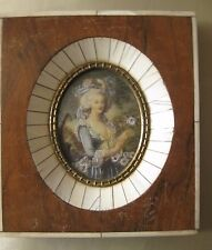 Nice miniature portrait painted on celluloid. Framed