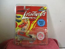 JOHNNY LIGHTNING COMMEMORATIVE LIMITED EDITION RED MOVIE VAN W/ PROTECTO