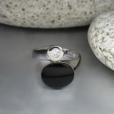Ring mit 0,10ct Brillant W-si und einem Onyx in 585/14K Weißgold