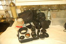 Nikon equipment: Misc lens caps, many filters, boxes, flash hand grip, cases, et