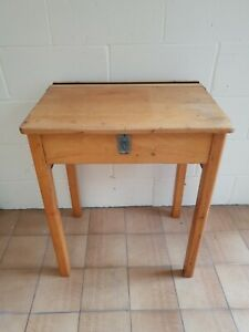 Vintage old wooden school desk and chair