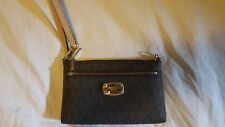 Micheal kors small hand bag strap unbuckles