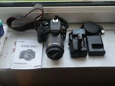 Canon EOS 100D Digital SLR Camera +EF-S 18-55 mm f/3.5-5.6 IS STM Lens with grip