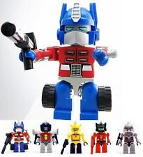 KRE-O TRANSFORMERS OPTIMUS PRIME USB HUB + IPHONE EAR CAP PLUG MEGATRON SET