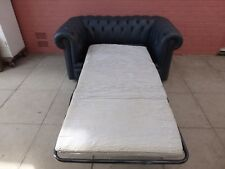 A Blue Leather Chesterfield Two Seater Sofa Bed