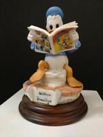 Disney Donald Duck reading Comic Capodimonte  Figurine C.O.A. Original Box