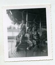 1950s  snapshot Photo  Girl on carousel horse Merry go round carnival