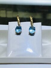 14k Solid Yellow Gold Genuine Blue Topaz Dangling Lever Backing Earrings. 2.3