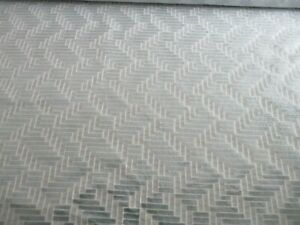 ROLL END OF 4.8 METRE OF BLUE GREY CHENILLE GEOMETRIC DESIGN UPHOLSTERY FABRIC.