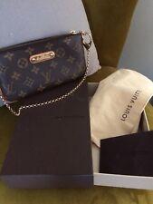 Louis Vuitton Pequeña Bolsa