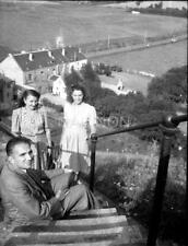 A small negative - Family on steep steps above houses - location unknown.