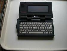Atari portfolio personal computer, mains adaptor, manual & 64 kb memory card