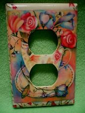 Vintage colorful Tea Cup of Flowers wrapped paper outlet cover.