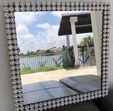 Silver Decor And Black Frame Mirror