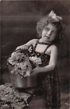 INNOCENT YOUNG GIRL WITH BUCKET OF FLOWERS~HUNGARIAN REAL PHOTO POSTCARD 1910