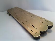 Antique brass and wood cribbage board and pegs.