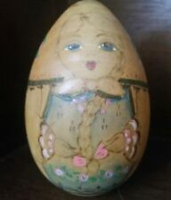 Vintage Handpainted Wooden Egg depicting a Dutch girl with braided hair & flower