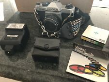 Pentax K1000 35mm Slr Film Camera with 50 mm lens, Accessories And Case.