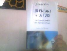 Julian Sher pour Un enfant a la fois