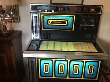More details for juke box very good order comes with 80 records. sold as seen.