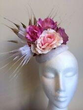 Gorgeous white fascinator with flowers and gold tipped feathers on a headband!