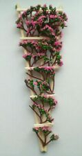 A HANDMADE DOLLS HOUSE TRELLIS WITH PINK CLIMBING FLOWERS PLANT