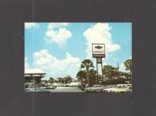 BUSINESS CARD:  ROGER WHITLEY CHEVROLET AUTOMOBILE DEALERSHIP - TAMPA, FLORIDA