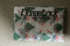 OBLONG CHRISTMAS TABLECLOTH. WIPEABLE VINYL TOP. 52in x 70jn. BRAND NEW IN BAG..