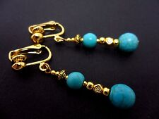 A PAIR OF TURQUOISE & GOLD COLOUR DANGLY CLIP ON EARRINGS. NEW.