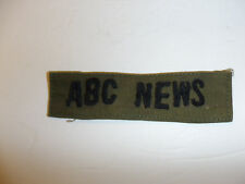 c0352 Vietnam era ABC News name tape black on OD Fatigues R10E