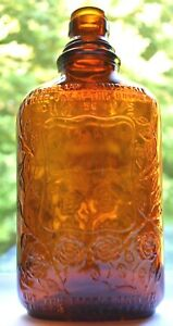 Empty Glass Amber FOUR ROSES Whiskey Bottle Embossed Flowers Early Pat. Pending