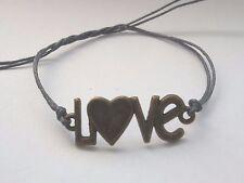 Grey string tie on bronze LOVE tag charm bracelet karmastring friendship boho