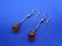 A PAIR OF ANTIQUE VINTAGE SILVER & AMBER LONG DROP EARRINGS