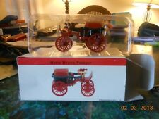 two die- cast horse drawn pumpers from 2001 readers digest in there boxes