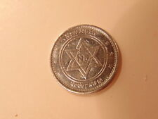 Steel or silver colored token showing New Japan and Star of David with NJ inside